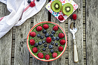 Green kiwi smoothie with blueberries and raspberries and chia seeds in bowl - SARF002085