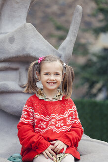 Portrait of a smiling little girl with braids wearing red-white knit pullover - XCF000011
