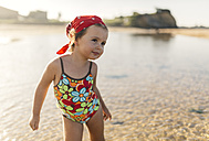 Portrait of smiling little girl wearing swim suit with floral design - MGOF000724