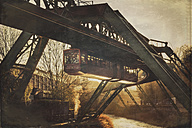 Germany, Wuppertal, overhead railway by sunset - DWI000603