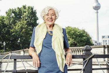 Germany, Berlin, portrait of smiling senior woman - TAMF000328