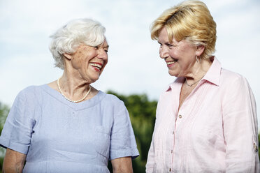 Germany, Berlin, portrait of two laughing senior women - TAMF000337