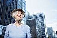 Germany, Berlin, portrait of smiling senior woman watching something - TAMF000342