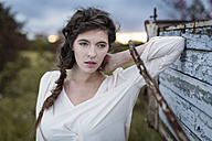 Portrait of woman with braid at twilight - SHKF000371