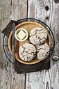 Homemade rye bread rolls on wooden plate and cooling grid - EVGF002428