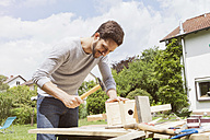 Man timbering a birdhouse - RBF003160