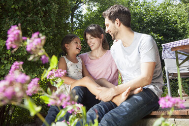 Happy family with daughter in garden - RBF003230