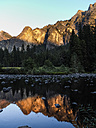USA, California, Yosemite Valley, Sunset in the mountains reflecting in water - SBDF002234