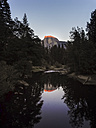 USA, California, Yosemite National Park, Sunset at Half Dome reflecting in water - SBDF002241