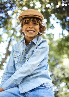 Portrait of smiling blond boy wearing cap - MGOF000760