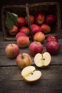 Red apples, sort Gala, basket on wood - LVF003846