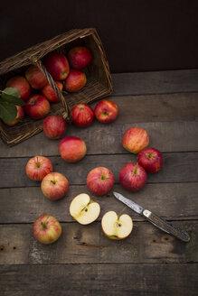 Red apples, sort Gala, basket and pocket knife on wood - LVF003849