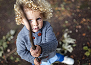 Portrait of little boy holding a stick - MGOF000792