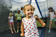 Portrait of girl on trampoline - MGOF000798