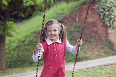 Portrait of little girl on a swing - XCF000035