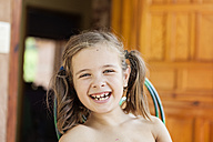 Portrait of happy little girl with braids and tooth gaps - XCF000038