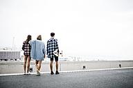 Three friends longboarding in the city - JRFF000090