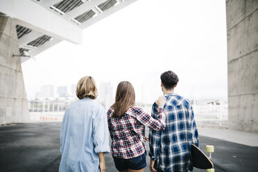 Three friends longboarding in the city - JRFF000102