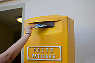 Italy, Rome, Vatican City, dropping of a post card into letterbox - KLR000155