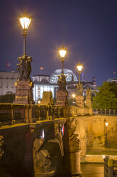 Germany, Berlin, historic bridge and Reichstag at night - NKF000409