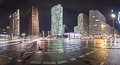 Germany, Berlin, Panoramic view of Potsdamer Platz during a rainy night - NKF000415