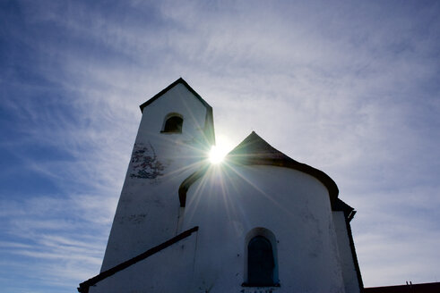 Austria, Tyrol, Kitzbuehel, Pilgrimage church Hohe Salve against the sun light - JEDF000248
