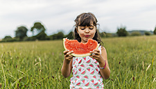 Little girl eating watermelon - MGOF000799