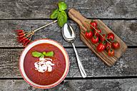 Bowl of homemade tomato soup on wood - SARF002158