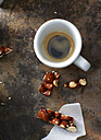 Cup of espresso and leftover of homemade brittle - KSWF001581