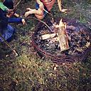 Three children at camp fire - LVF003945