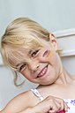 Portrait of blond little girl with German Flag painted on her cheek - JFEF000717