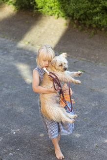 Little girl carrying her mongrel - JFEF000723
