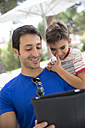 Portrait of father and son with digital tablet - ERLF000047