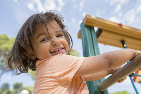 Portrait of smiling little girl on a playground - ERLF000059
