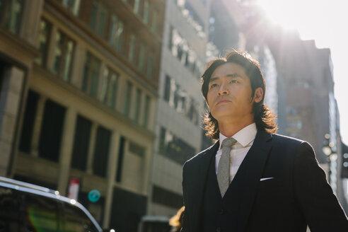 USA, New York City, confident businessman in Manhattan - GIOF000217