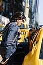 USA, New York City, businessman entering a taxi - GIOF000232