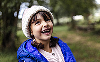 Portrait of laughing little girl with tooth gap - MGOF000810
