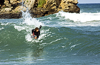 Spain, Asturias, Colunga, body board rider on the waves - MGOF000828