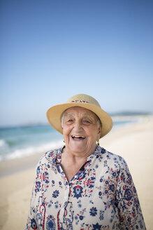 Spain, Ferrol, portrait of laughing senior woman on the beach - RAEF000531