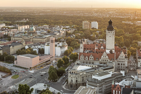Germany, Saxony, Leipzig, View to New Townhall, St. Trinitatis and Federal Administrative Court at sunset - MELF000093