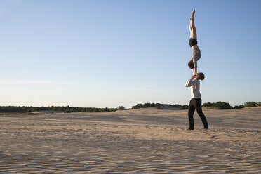 Netherlands, Acrobat couple performing hand to hand stands - NNF000292
