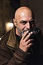 Portrait of smoking bald man - JASF000142