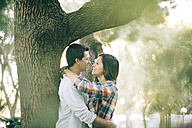 Young couple in love hugging in a park - JRFF000123