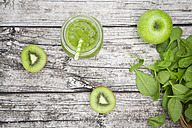 Glass of apple kiwi spinach smoothie and ingredients - LVF003963