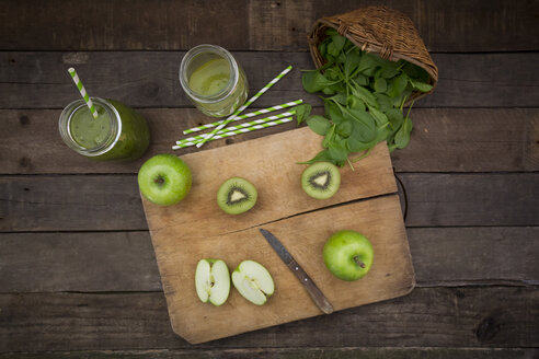 Two glasses of apple kiwi spinach smoothie and ingredients - LVF003969