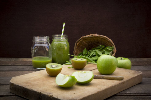 Two glasses of apple kiwi spinach smoothie and ingredients - LVF003972