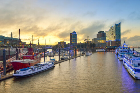 Germany, Harbour at sunrise, with Elbphilharmonie and Hanseatic Trade Center in background - RJF000509