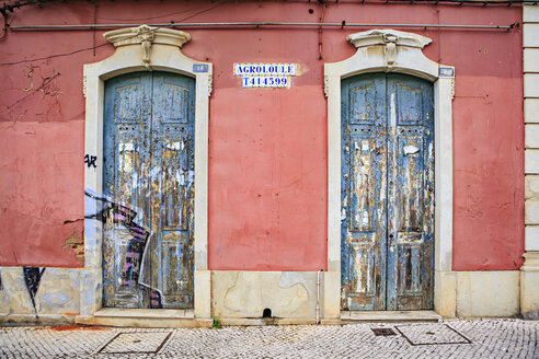 Portugal, facade of an old house with two entry doors - VTF000449