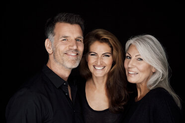 Portrait of three smiling people in front of black background - CHAF001536