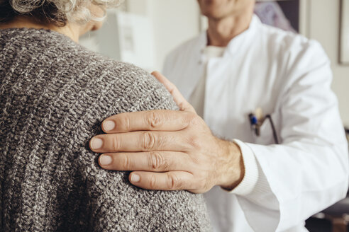 Doctor soothing senior patient - MFF002309